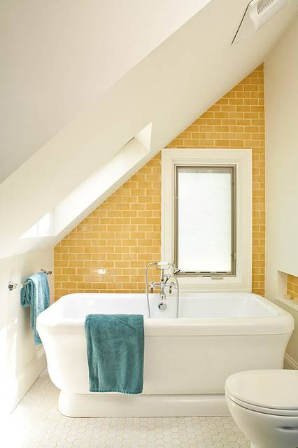 beach style bathroom with yellow brick wall design