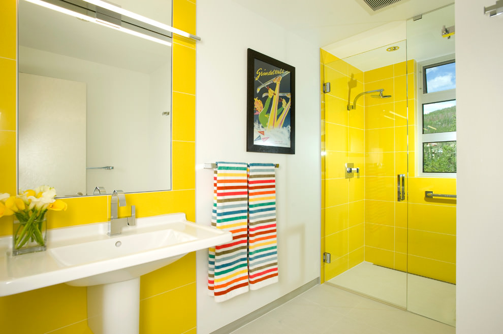 Modern bathroom with yellow design walls
