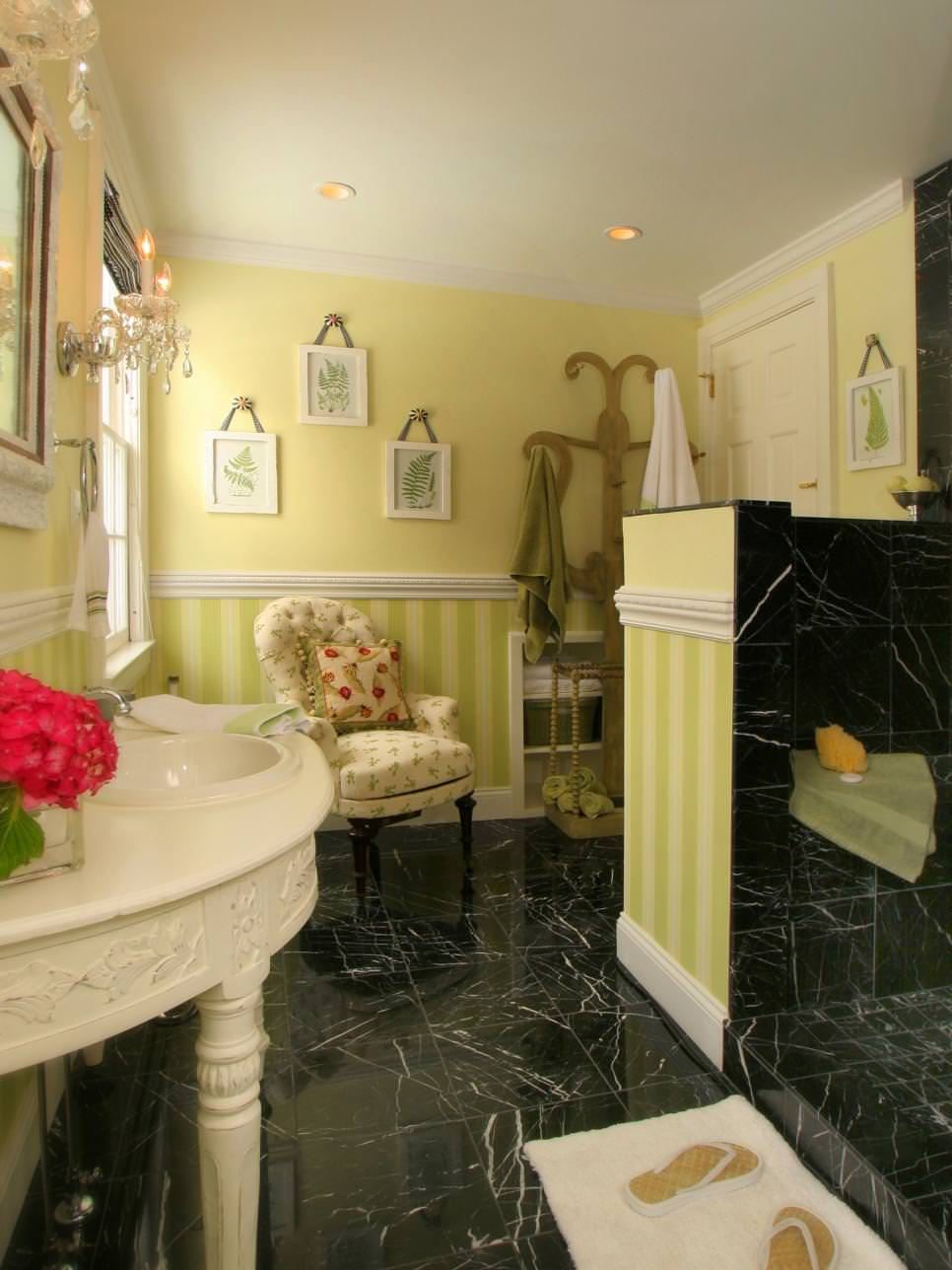 yellow cottage bathroom with black marble tile