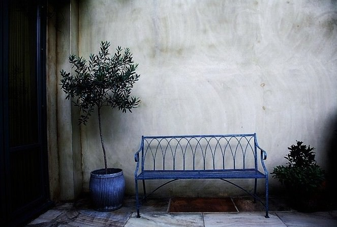 rustic iron bench design in traditional landscape