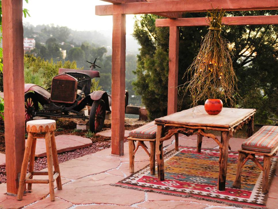southwestern outdoor dining room with wooden benches