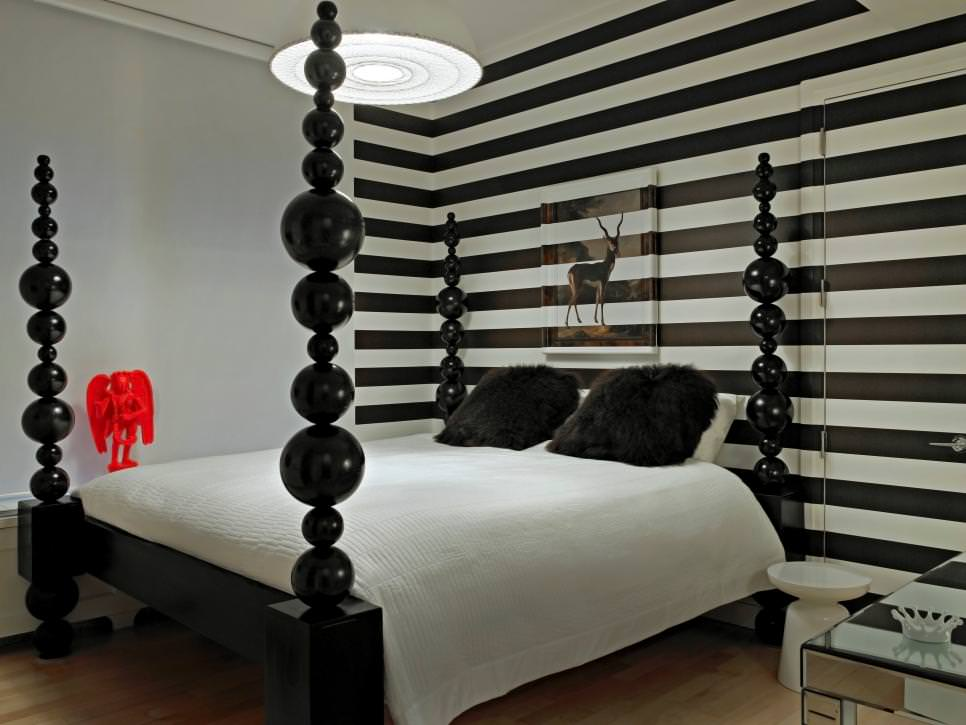 master bedroom with black white striped accent wall