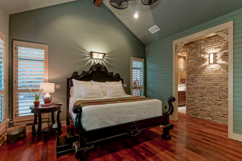 traditional blue bedroom with elegant dark wood bed