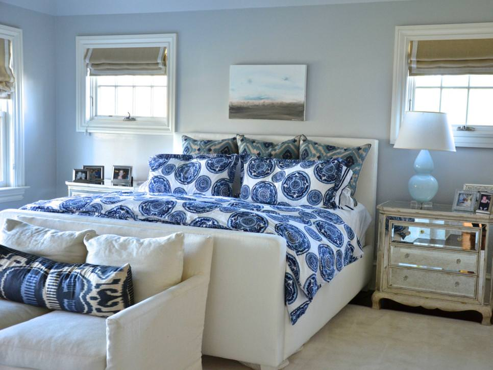 transitional bedroom boasts blue patterned design