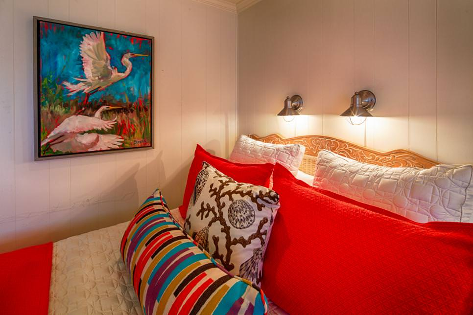 Bold Coastal Guest Bedroom With Bird Painting on wall