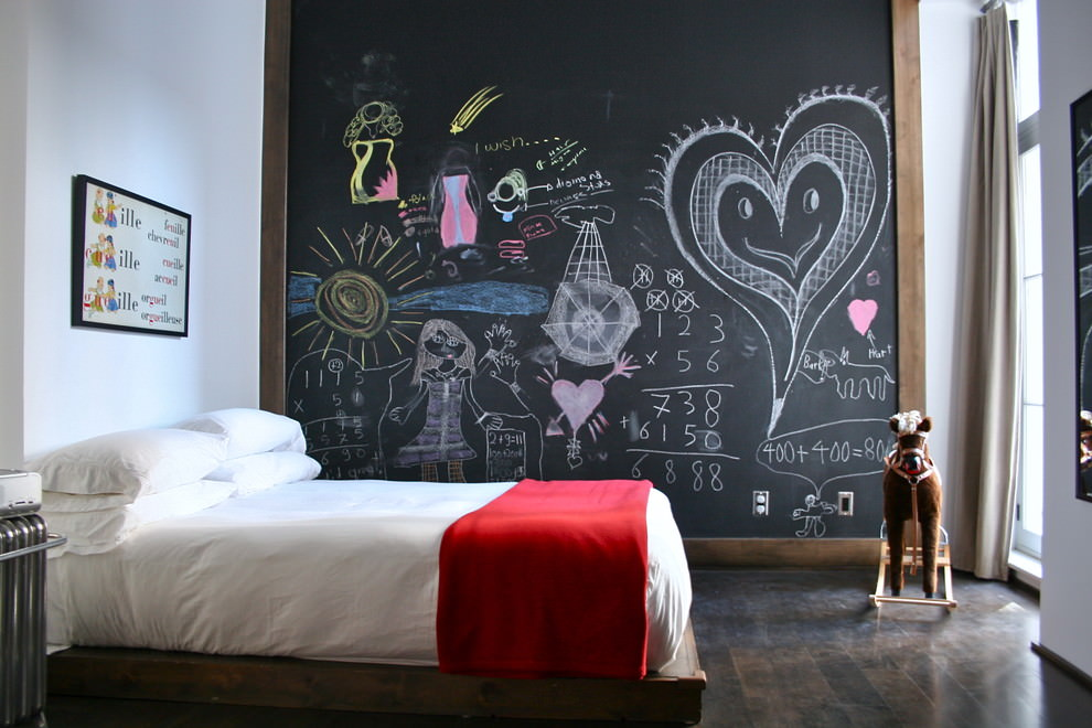 eclectic kids room with chalkboard wall design
