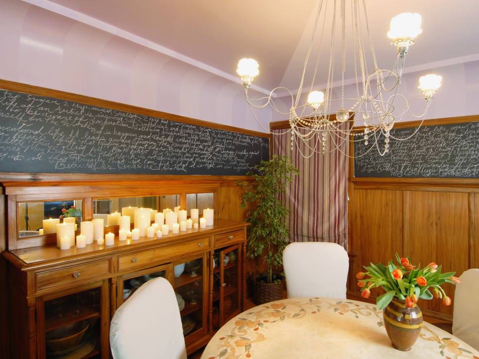 Dining Room With Elegant Chandelier and Chalkboard