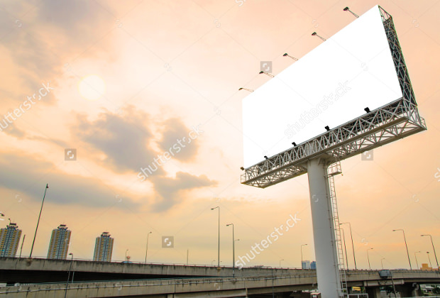 large blank billboard banner on road with city view background