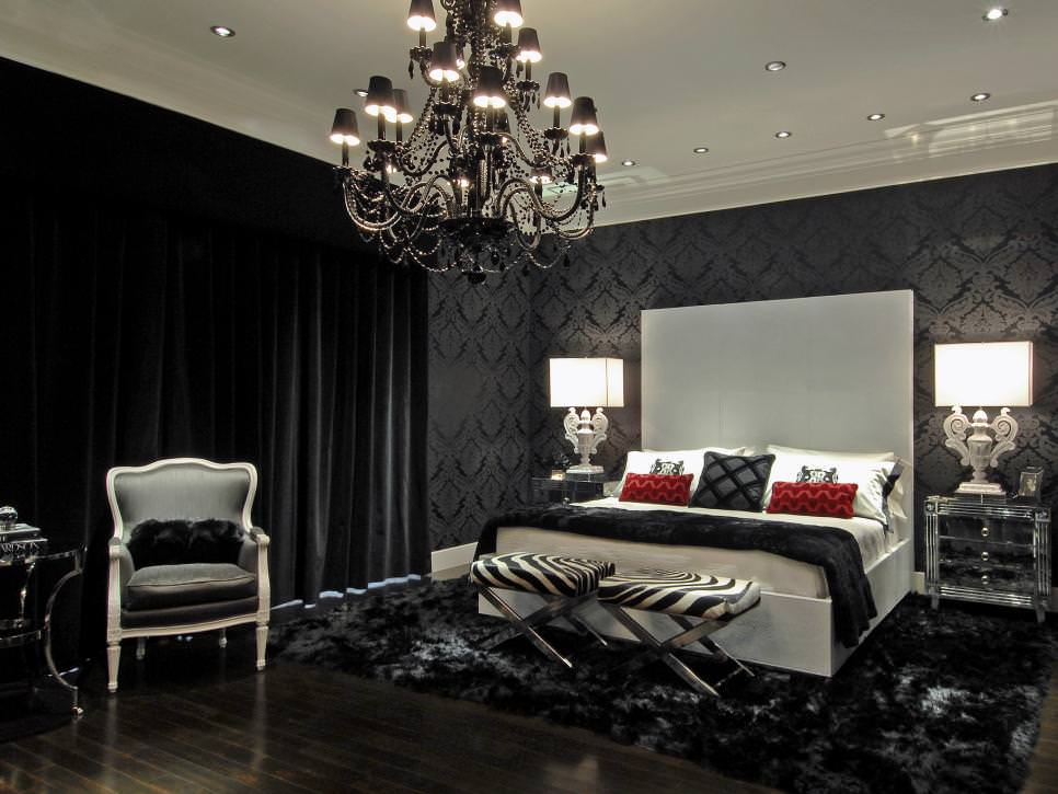 black bedroom with black chandelier