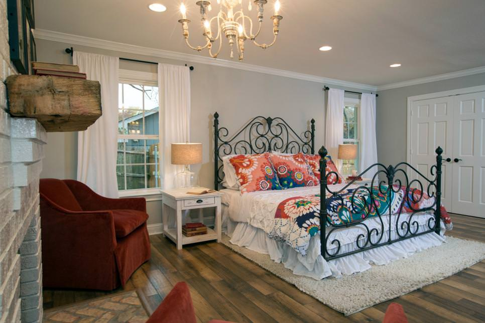 Master Bedroom With Metal Chandelier