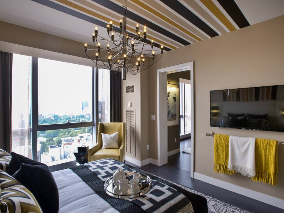 Master Bedroom With Yellow Accents and Metal Chandelier