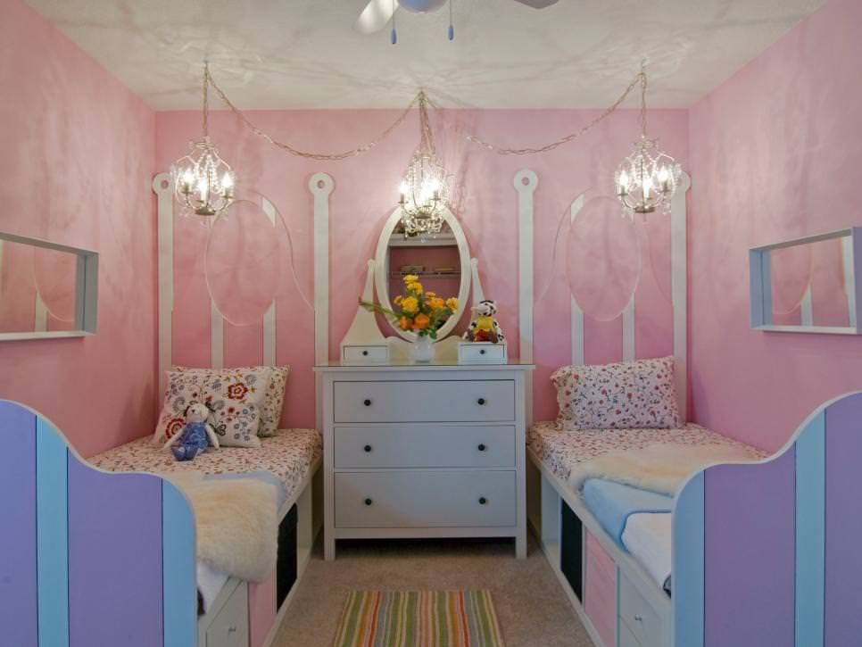 Pink Girl's Bedroom With Twin Beds and Chandeliers