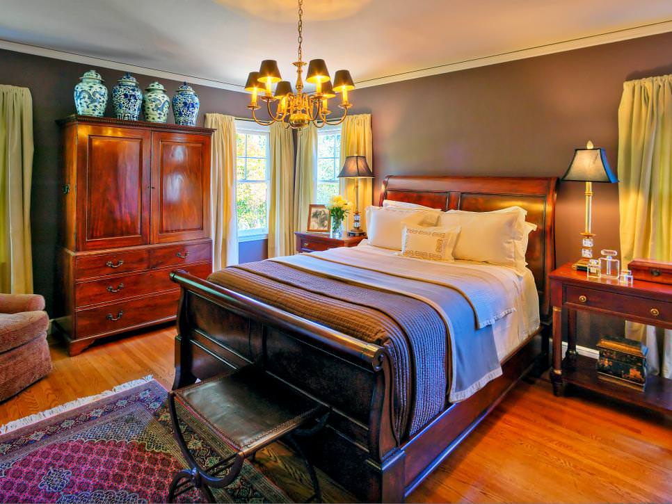 Traditional Bedroom With Sleigh Bed and Chandelier