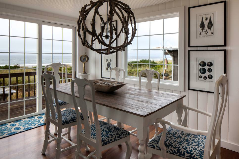 Coastal Dining Room With Chandelier