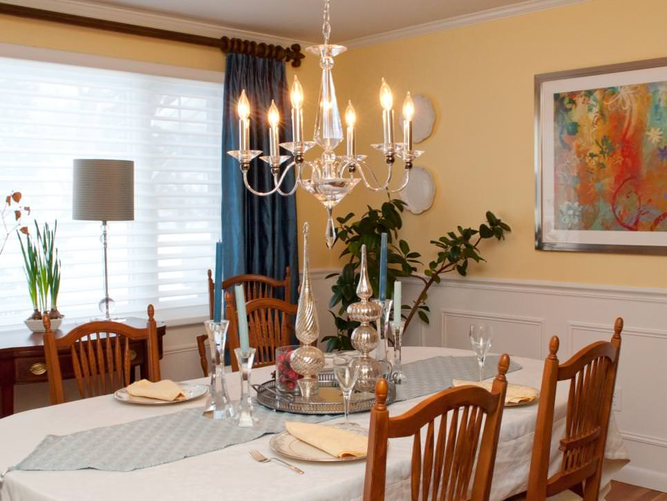 Cottage Dining Room With Chandelier