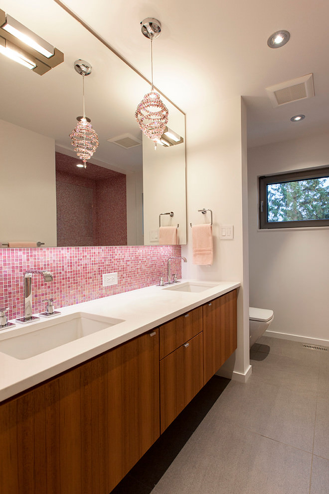 contemporary bathroom with light pink chandelier