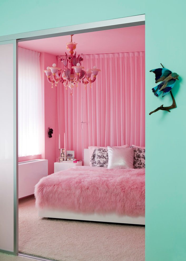 eclectic bedroom with bright pink chandelier