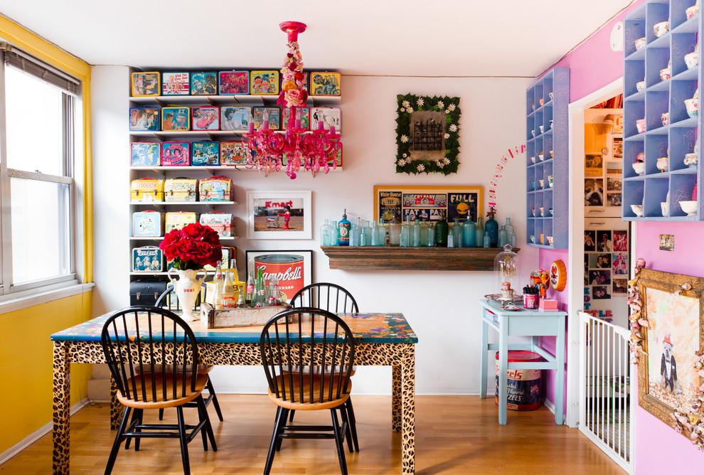 Eclectic dining room with pink chandelier