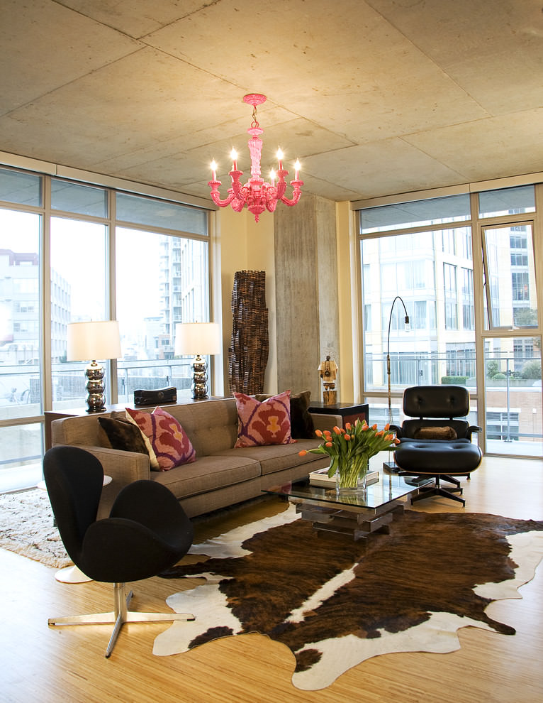 Industrial living room with pink chandelier