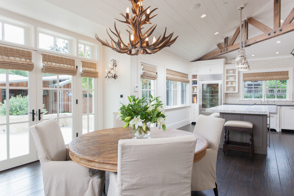 farmhouse dining room with antler chandelier design