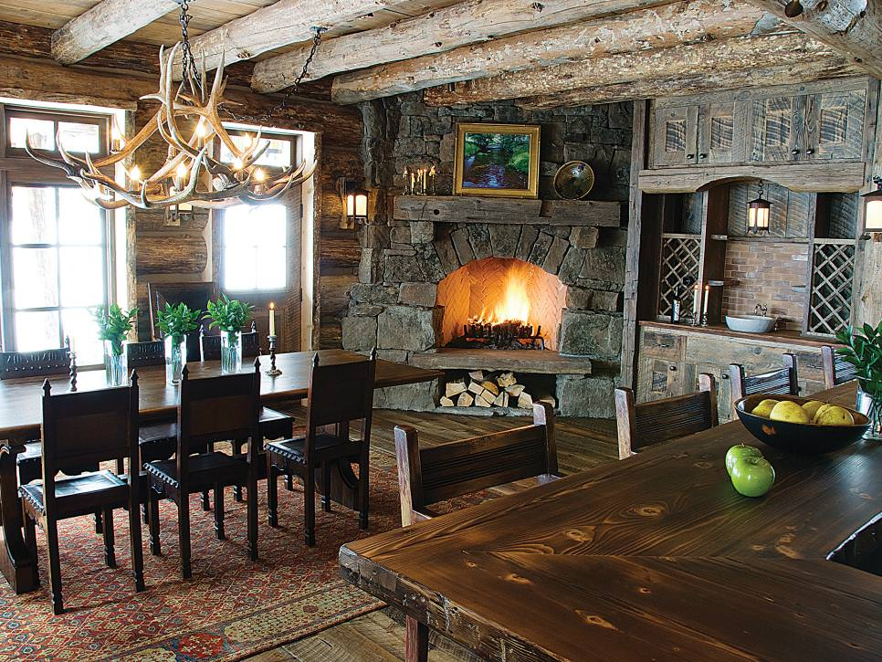 rustic dining room with corner fireplace and antler chandelier
