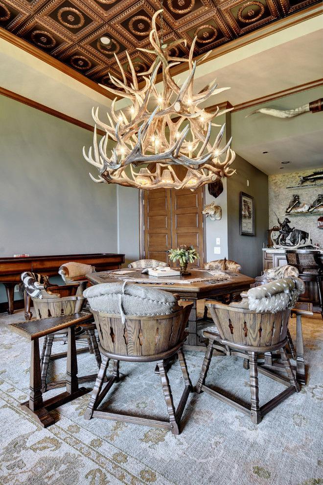 rustic dining table with large antler chandelier design