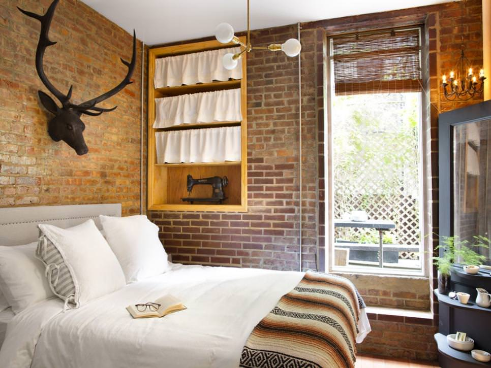 Bedroom With Exposed Brick And Antique Decor