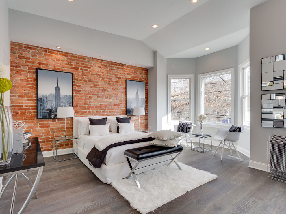 Contemporary bedroom with brick wall design