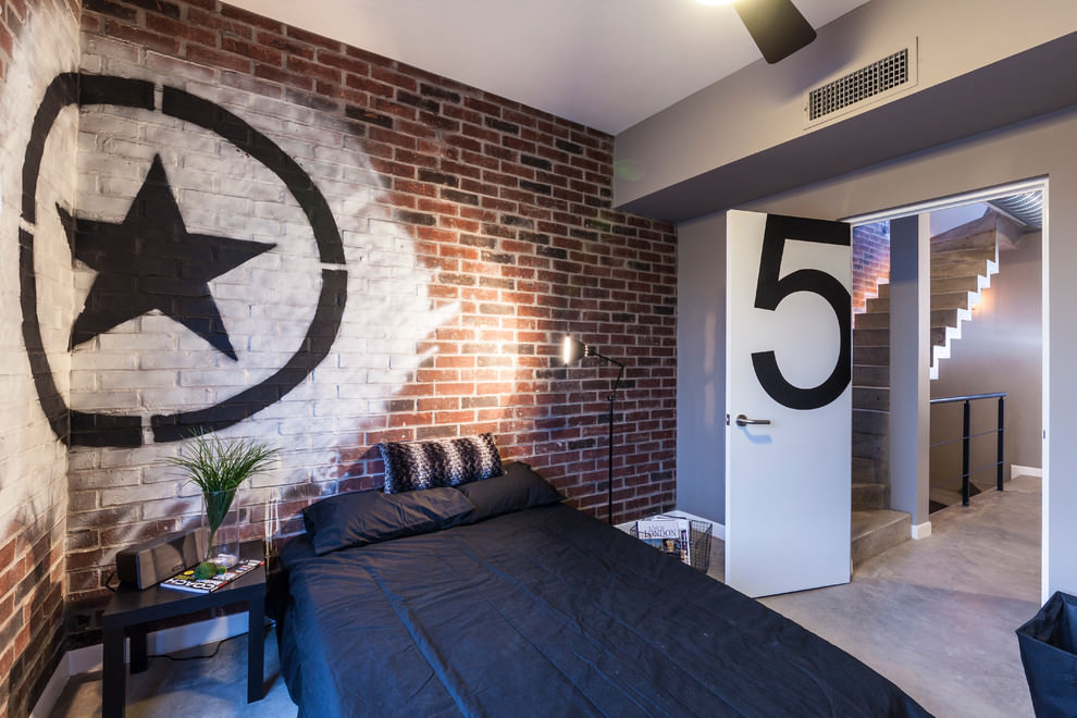 Contemporary bedroom with painted star brick wall design