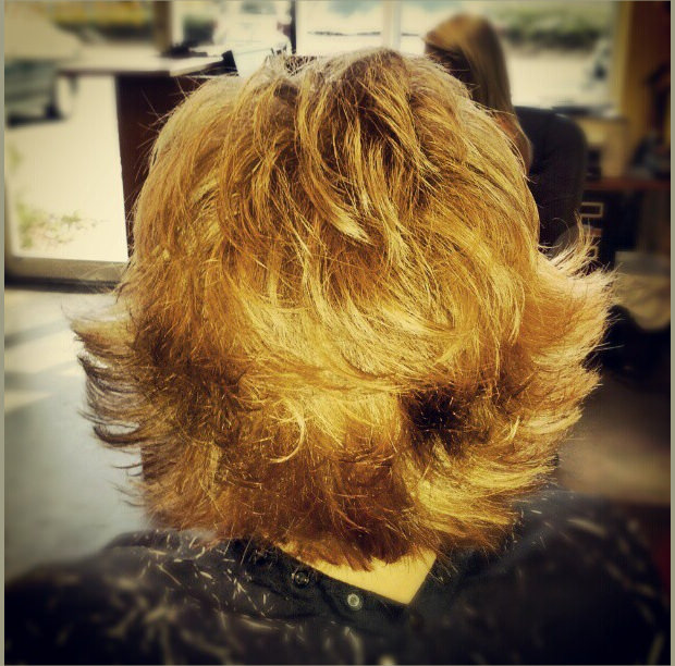 cute medium razor cut with strawberry blonde color