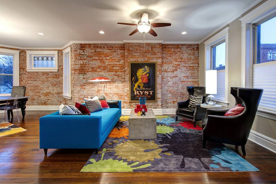Eclectic Living Room Features Brick Accent Wall
