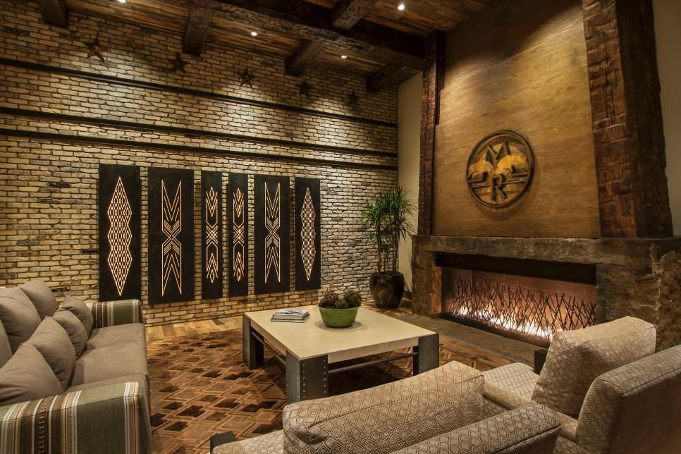 neutral southwestern living room with brick wall design - Rock Wall Design
