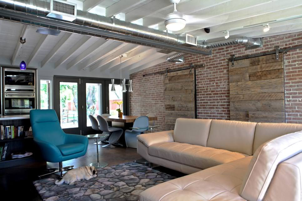 Open Concept Living Room With Exposed Brick Wall design