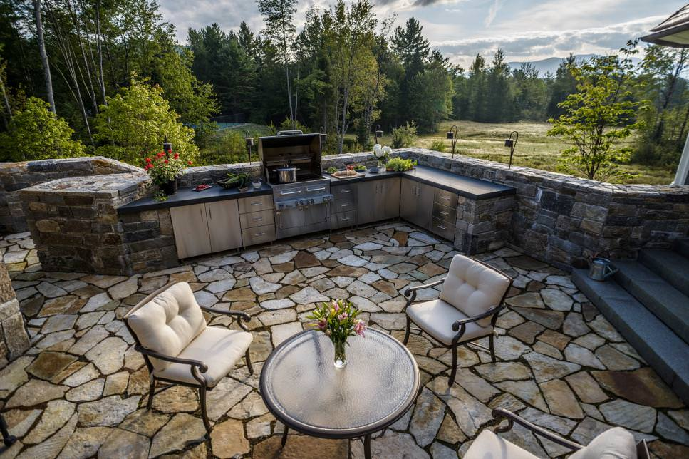 outdoor kitchen with stone walls design