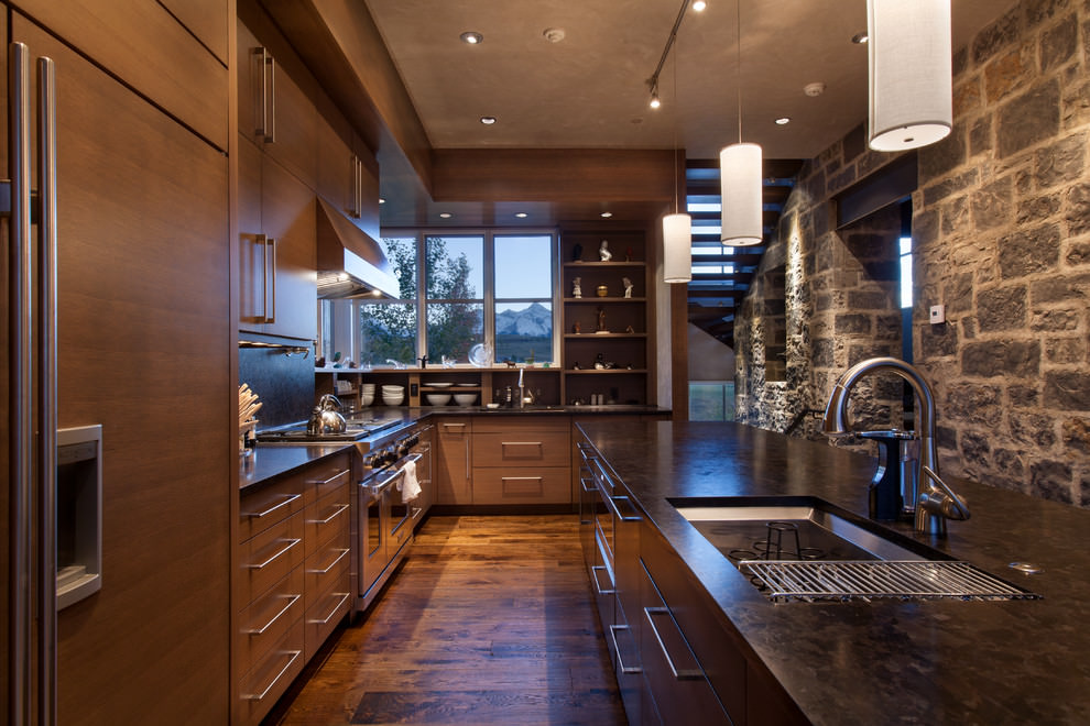 rustic kitchen with designed stone walls