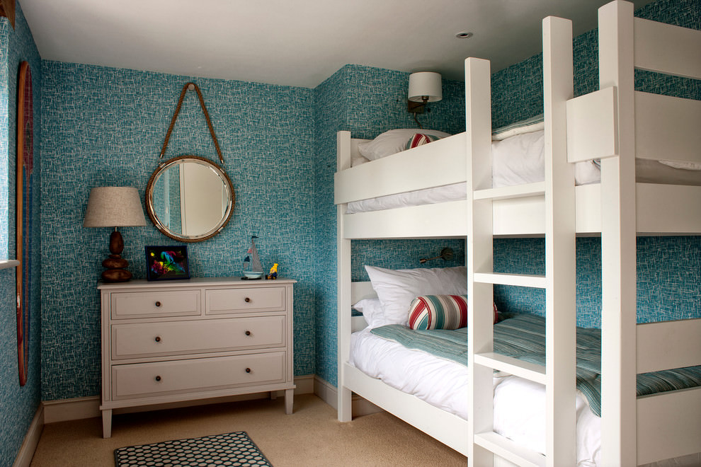 beach style bedroom with blue geometric wall paper design