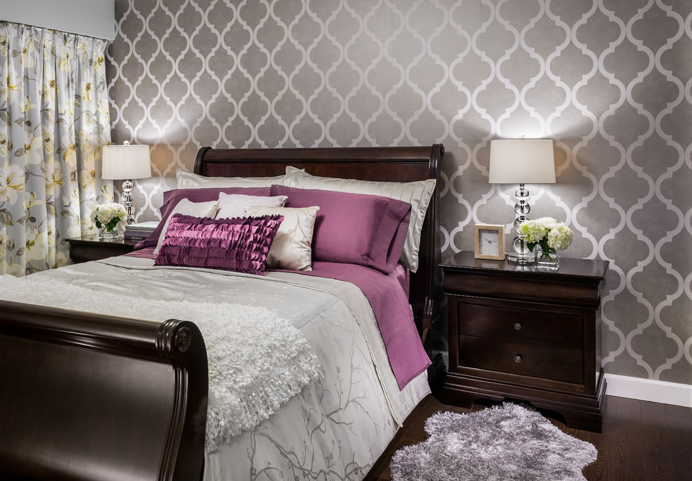 Transitional bedroom with geometric wall paper design