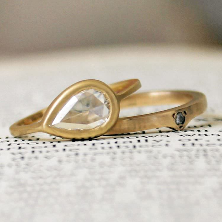 flat golden pear diamond ring