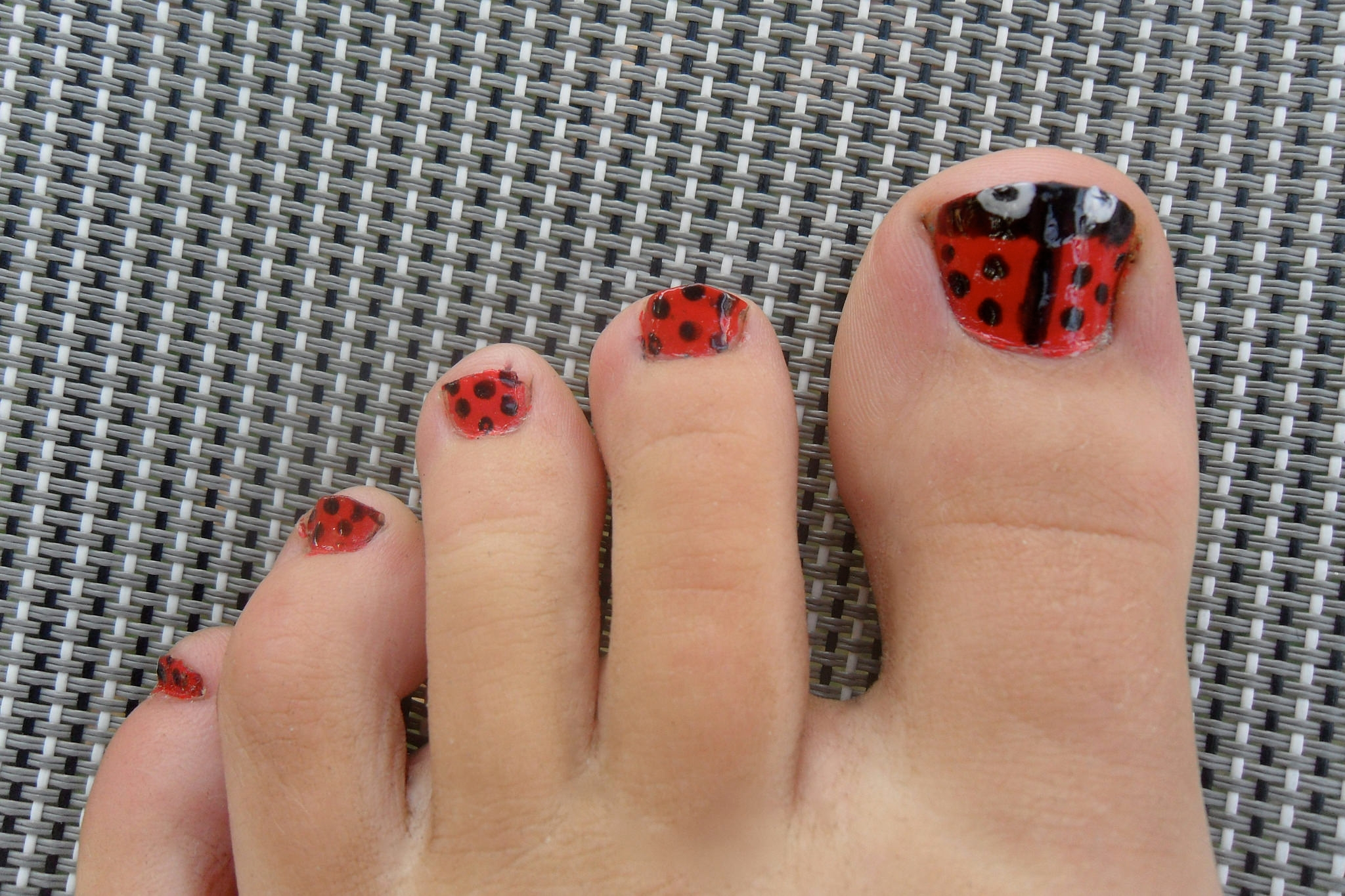 dots on red nail s