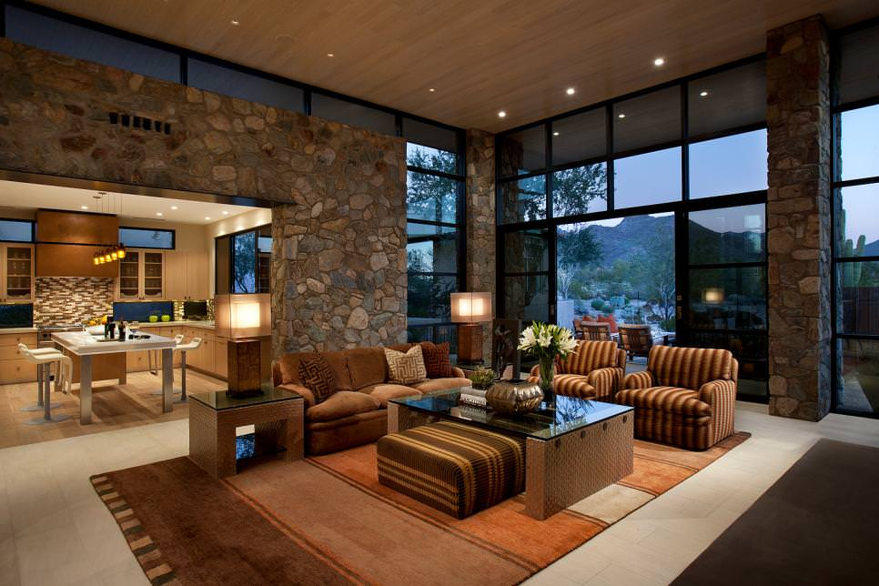 Southwestern Living Room with rock wall accent