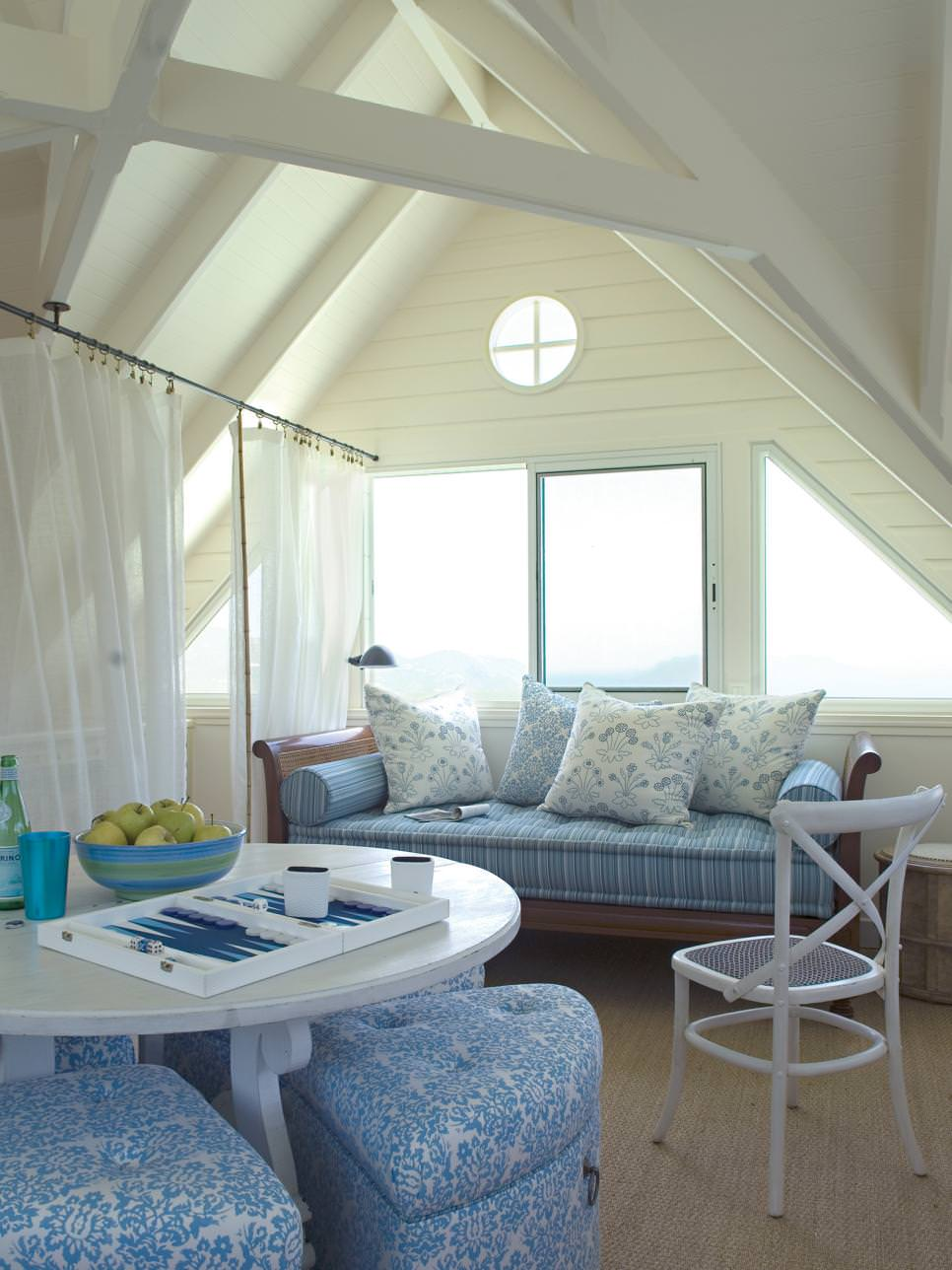 decorated daybed in coastal attic bedroom