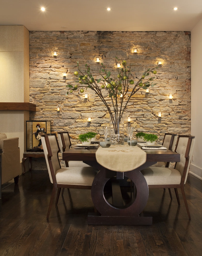 Contemporary dining room with blank stoned wall