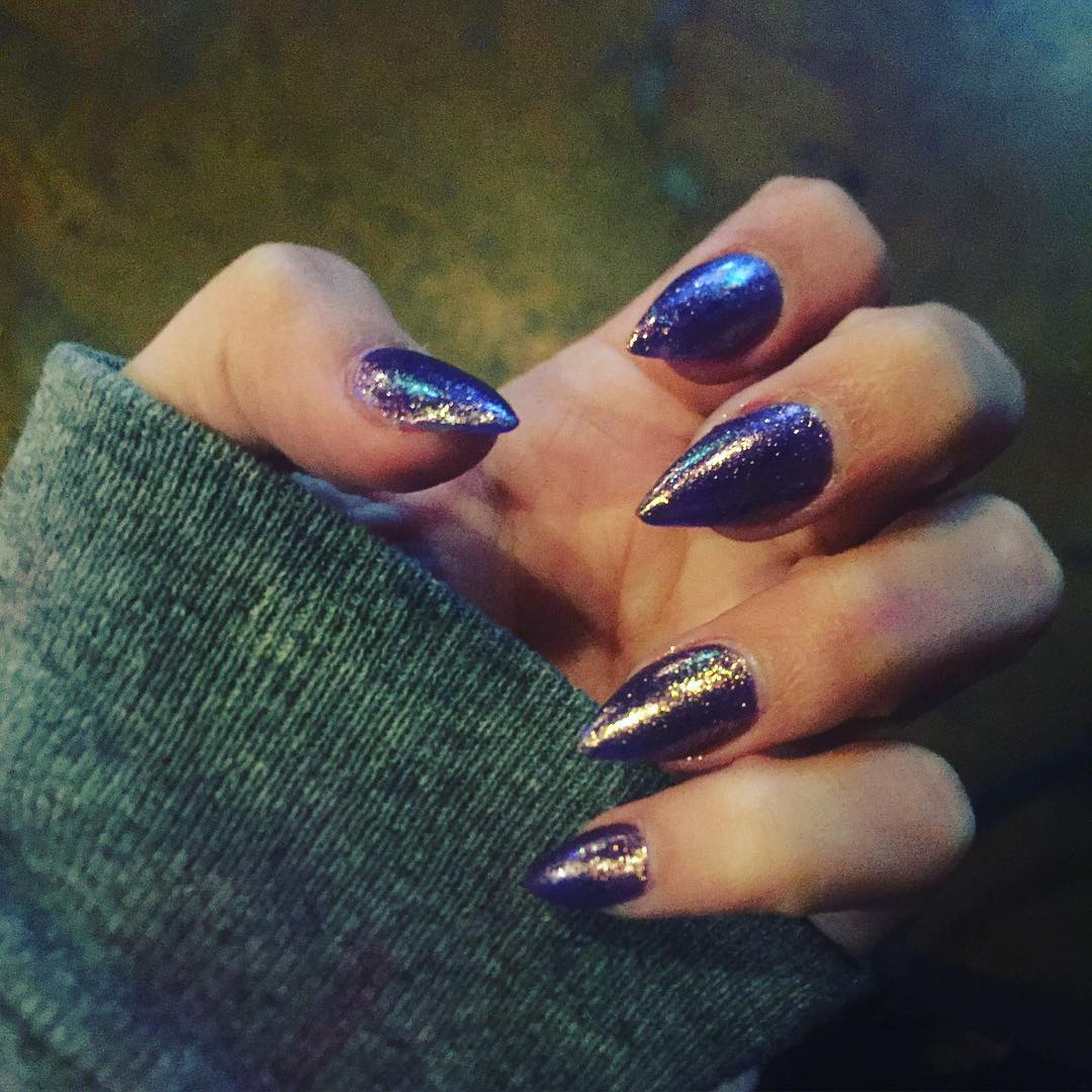 Purple Polished Nails