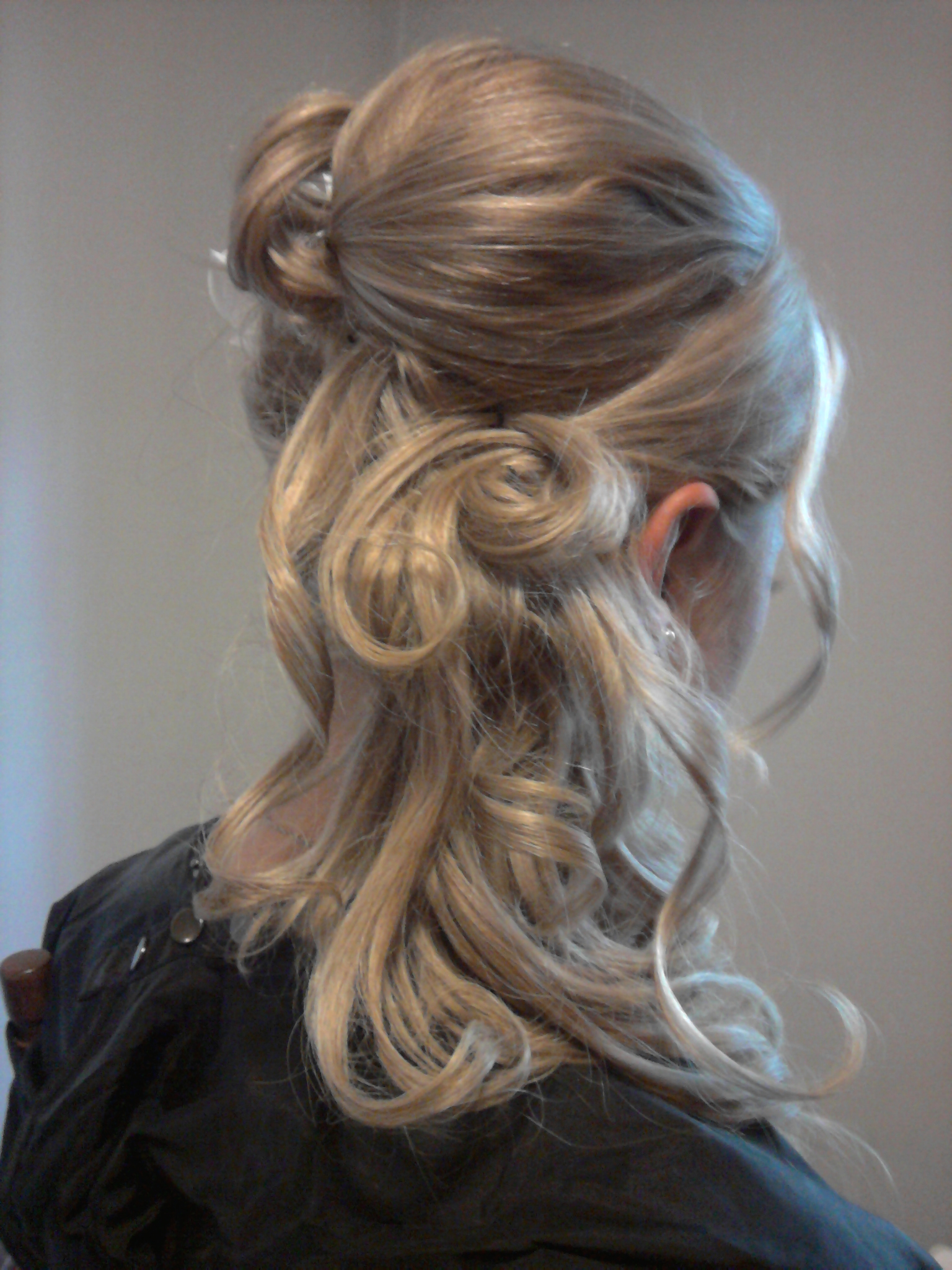 Creative Knot half up half down Wedding Hairstyle