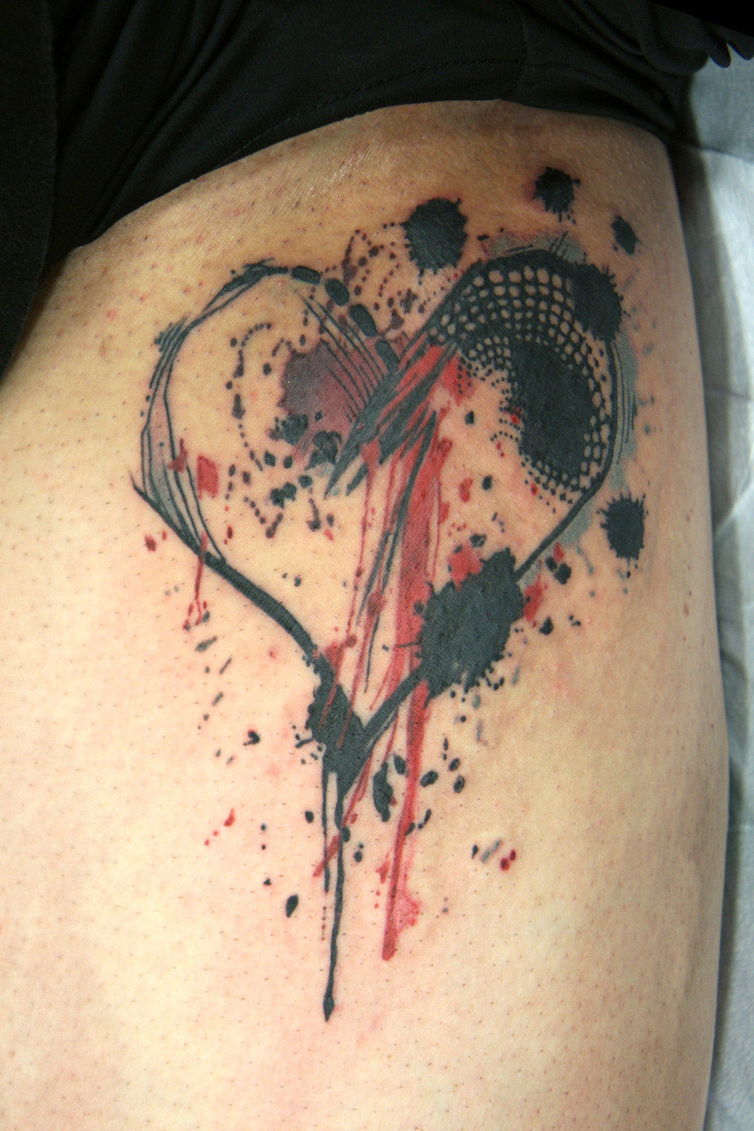 colorful heart shaped tattoo