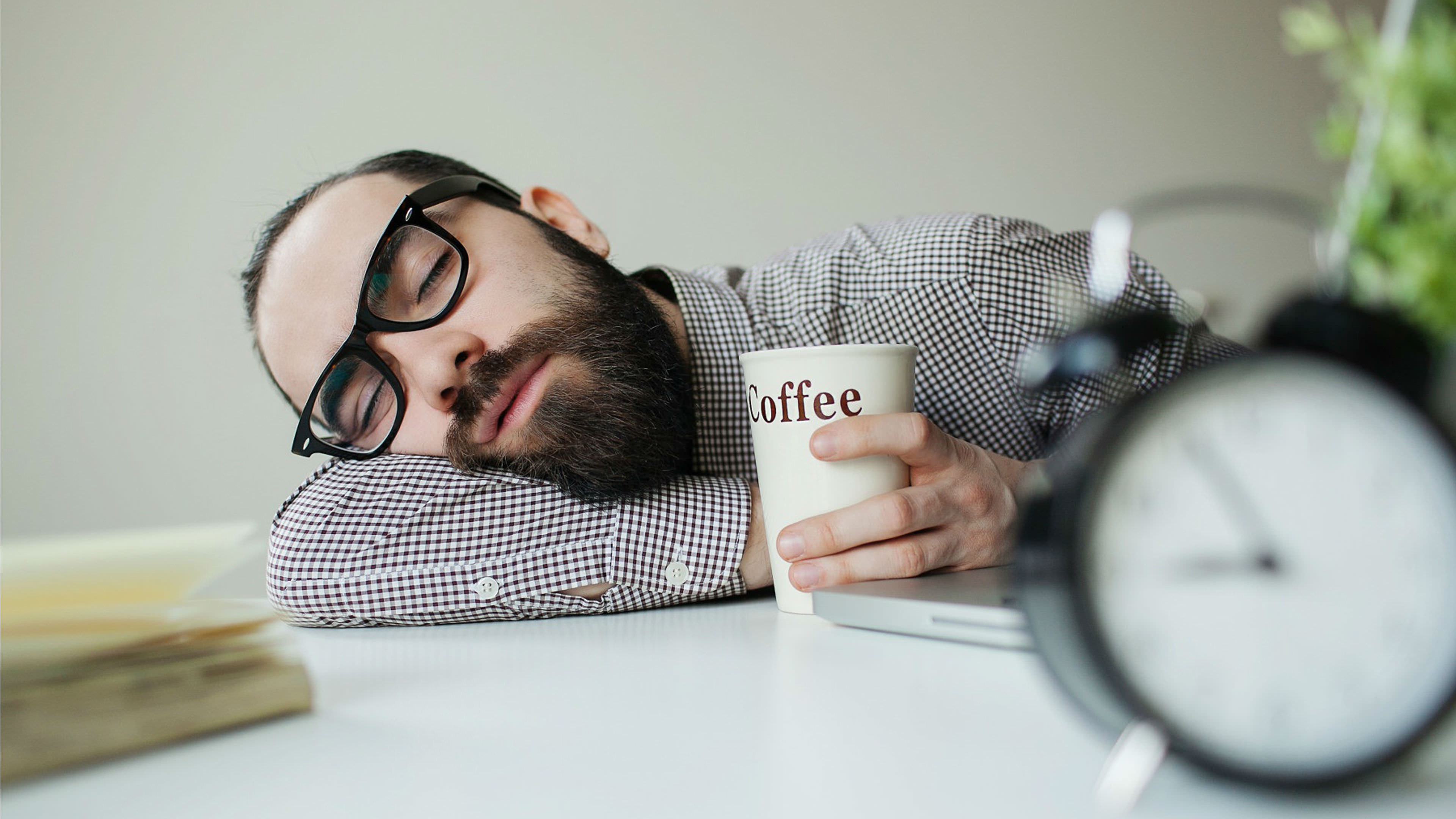 Sleeping Man with Coffee Cup