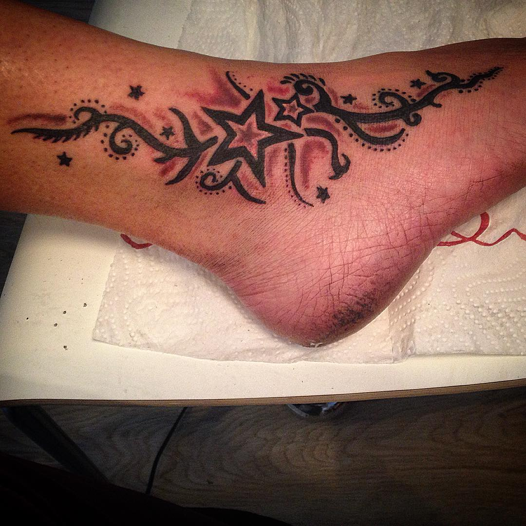 ankle decorated with star tattoo