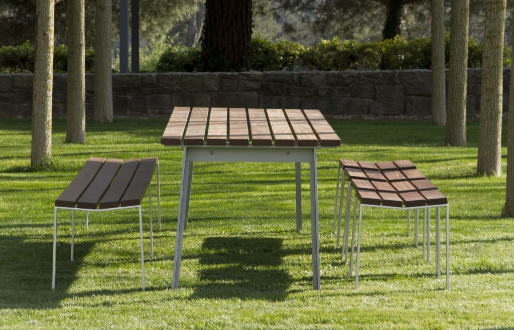 Wooden table with iron rods in garden