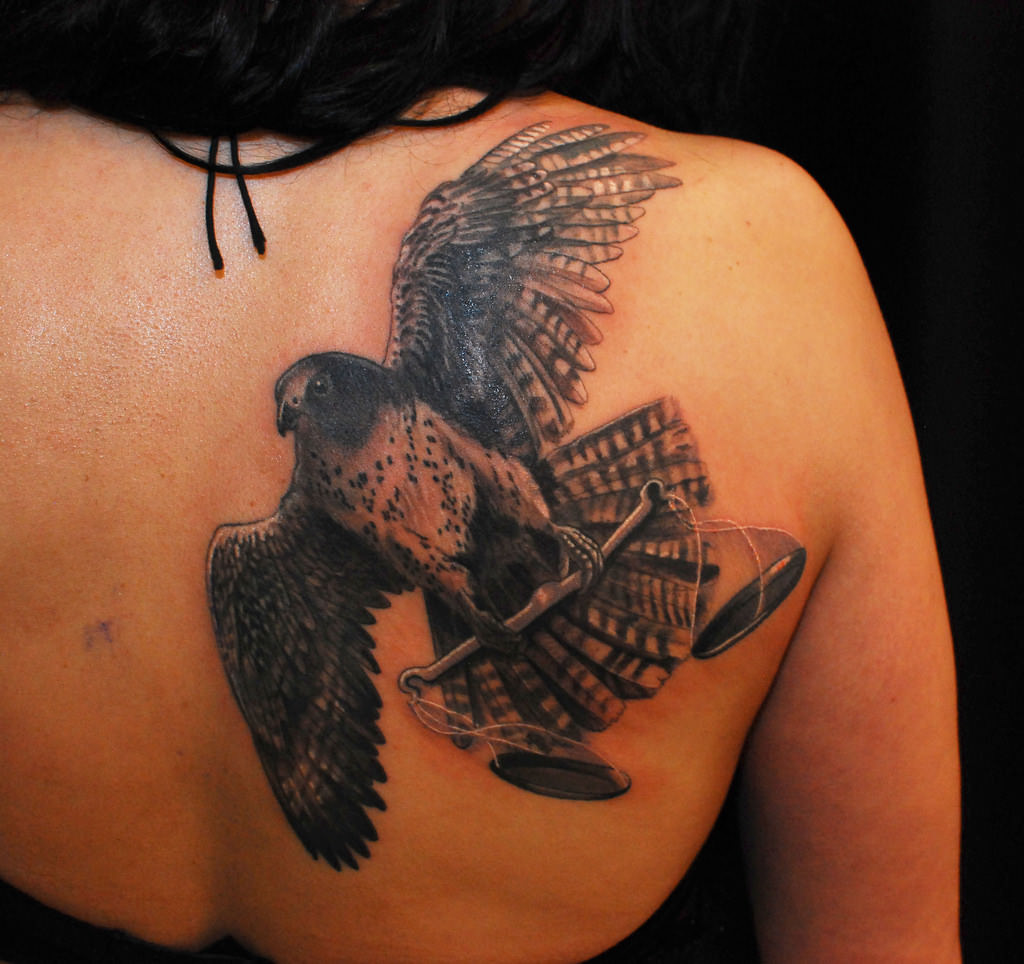 Falcon Carrying Libra Tattoo