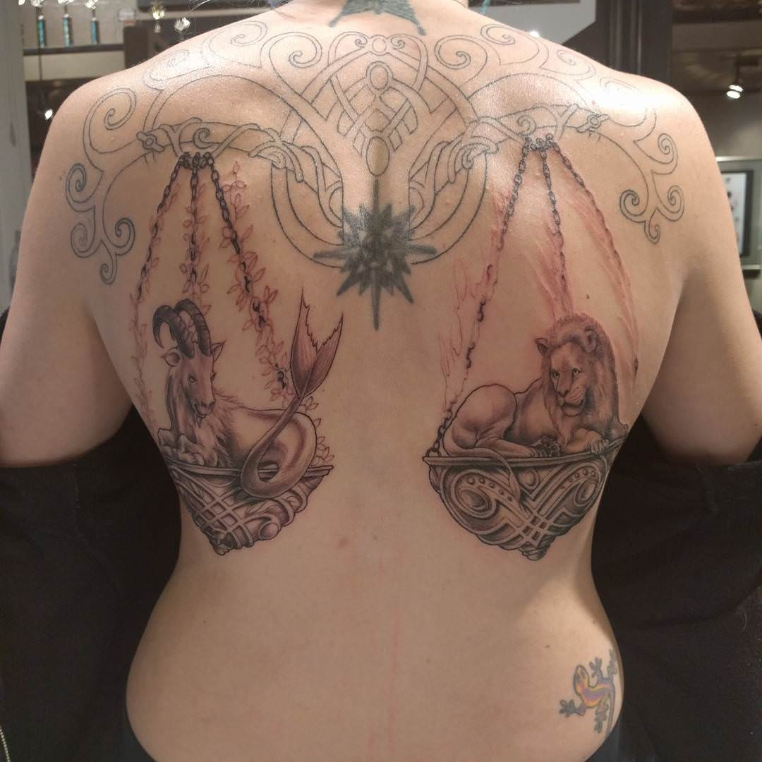Libra Carrying Animals Tattoo